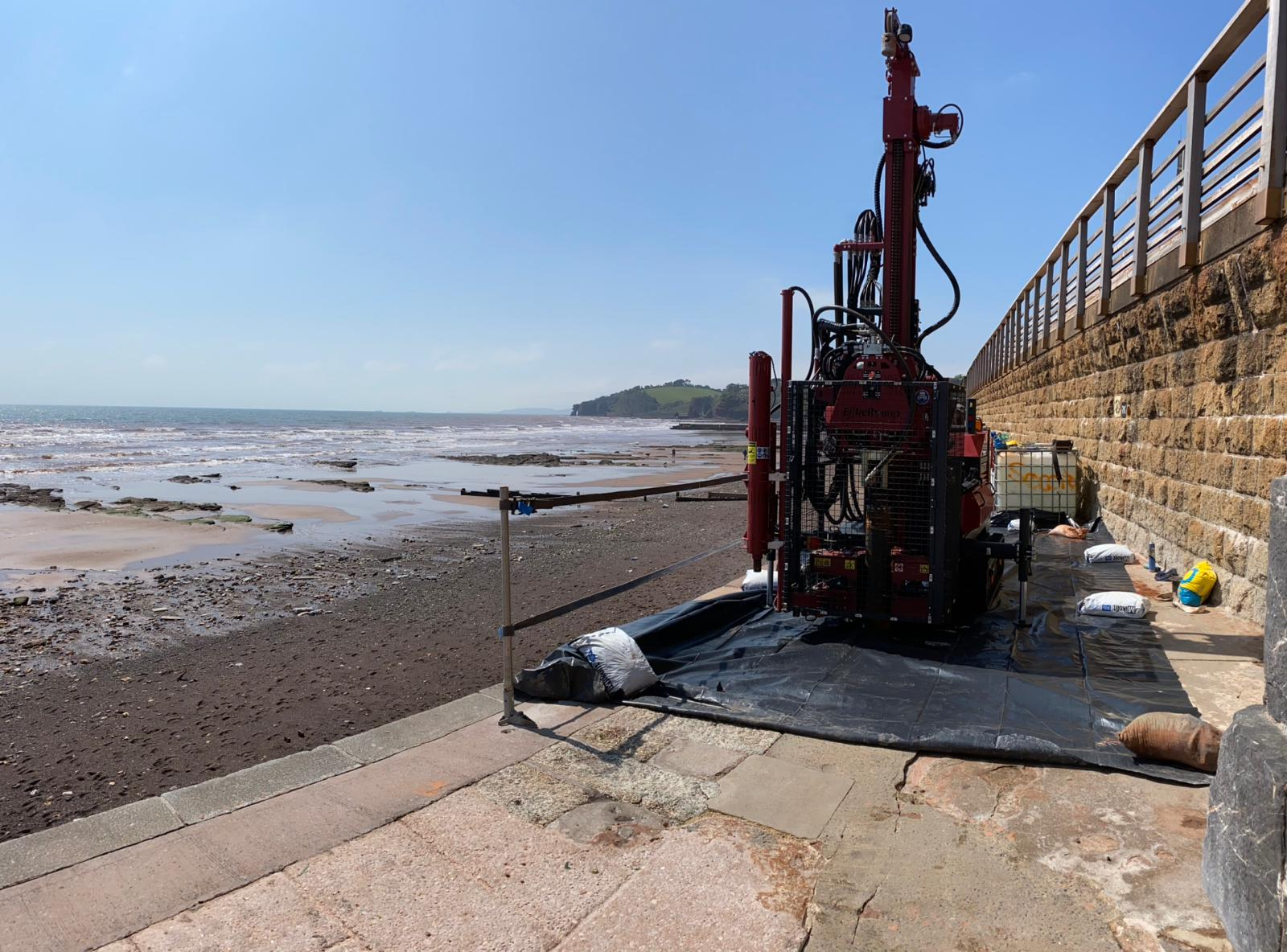 A sonic drilling rig in use by the beach