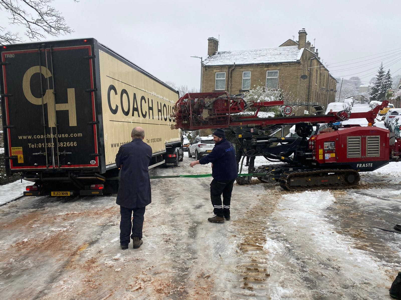 A sonic rig getting a lorry back onto the road.